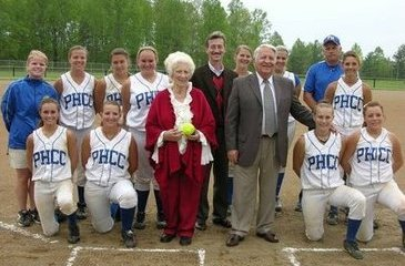 Tim Martin (center) and parents Fred and Lowanda Martin with the PHCC softball team on Martin Field