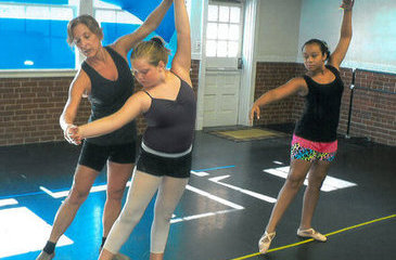 Melissa Lannom gives a lesson to dance students Sadie Leigh Perry and Zoie Shough.
