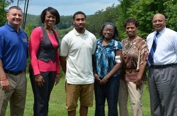 From left, Christopher Parker, Shermale Motley, Stephon Jamison, Kimberly King, Mary Mason and Bishop J.C. Richardson Jr.
