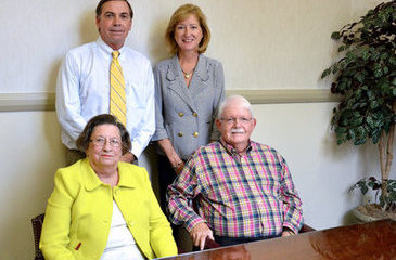 "Adelia ""Dee"" Moore Smith (front, left), Reed Moore (front, right), Henry G. Moore III (back, left)  and Nancy Moore (back, right)"